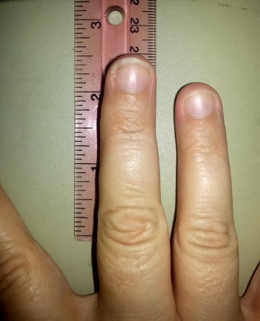When line up with the ruler at about the same place on my fingers that the hat was, can see that I have about 2.5in (6.35cm) to go before finishing.  Please excuse my nails.. they broke recently and I am trying to grow them back out..